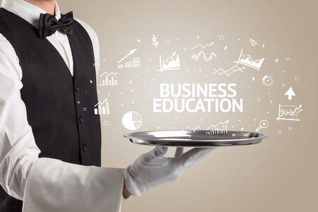 Waiter serving business idea concept with BUSINESS EDUCATION inscription