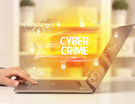 CYBER CRIME inscription on laptop, internet security and data protection concept, blockchain and cybersecurity