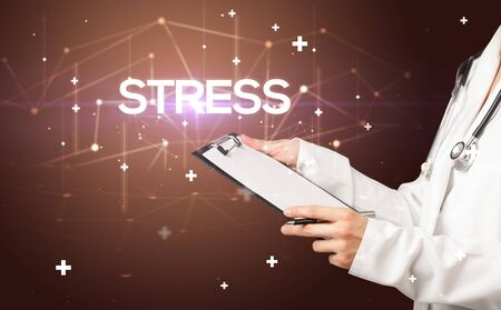 Doctor fills out medical record with STRESS  inscription, medical concept