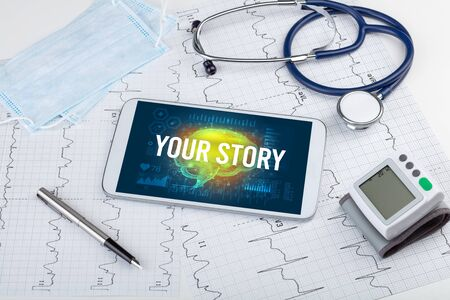 Tablet pc and medical tools with YOUR STORY  inscription, social distancing concept Фото со стока