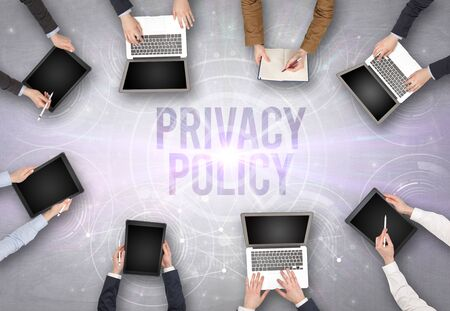Group of people in front of a laptop with PRIVACY POLICY insciption, web security concept Imagens