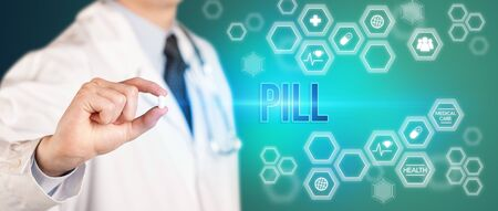 Close-up of a doctor giving you a pill with PILL inscription, medical concept