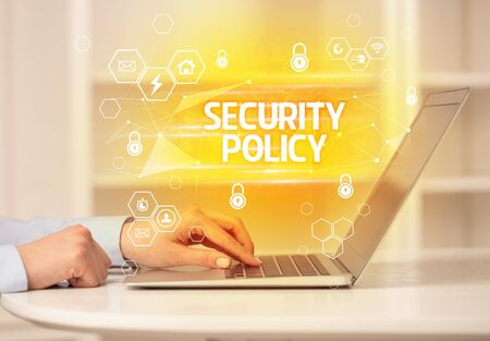 SECURITY POLICY inscription on laptop, internet security and data protection concept, blockchain and cybersecurity 免版税图像
