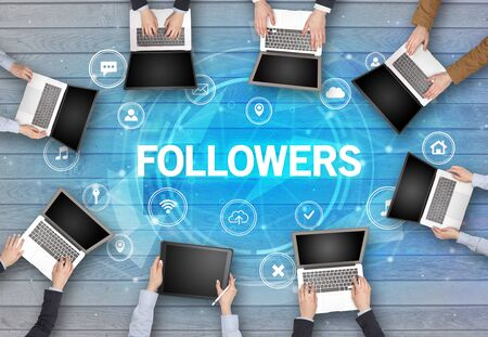 Group of people having a meeting with FOLLOWERS insciption, social networking concept Фото со стока