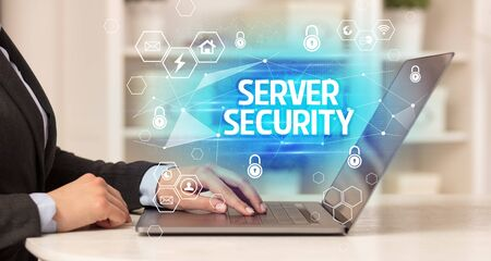 SERVER SECURITY inscription on laptop, internet security and data protection concept, blockchain and cybersecurity 免版税图像