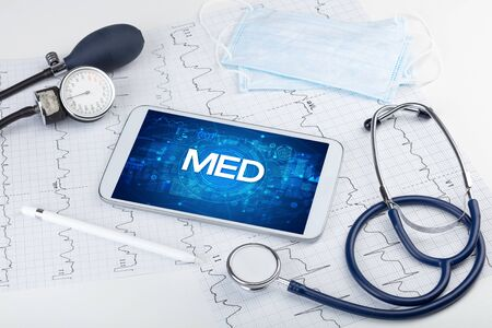 Close-up view of a tablet pc with MED abbreviation, medical concept Stock Photo