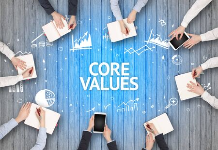 Group of Busy People Working in an Office with CORE VALUES inscription, succesfull business concept