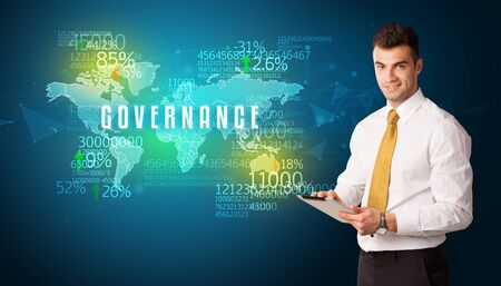 Businessman in front of a decision with GOVERNANCE inscription, business concept