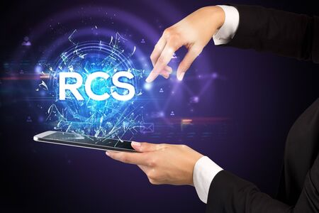 Close-up of a touchscreen with RCS abbreviation, modern technology concept Stock fotó