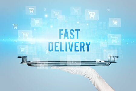 Waiter serving FAST DELIVERY inscription, online shopping concept 免版税图像