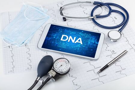 Close-up view of a tablet pc with DNA abbreviation, medical concept 免版税图像 - 150261022