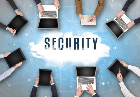 Group of people having a meeting with SECURITY insciption, web security concept