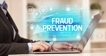 FRAUD PREVENTION inscription on laptop, internet security and data protection concept, blockchain and cybersecurity Foto de archivo