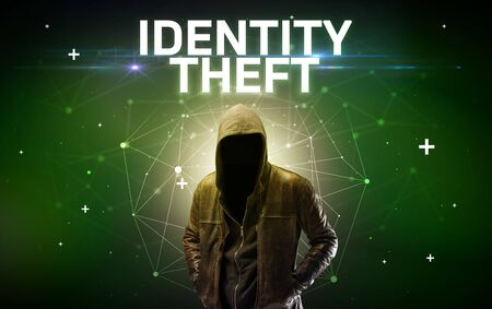 Mysterious hacker with IDENTITY THEFT inscription, online attack conceptinscription, online security concept