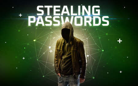 Mysterious hacker with STEALING PASSWORDS inscription, online attack concept inscription, online security concept