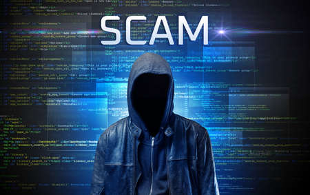 Faceless hacker with SCAM inscription on a binary code background