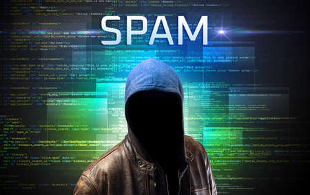 Faceless hacker with SPAM inscription on a binary code background