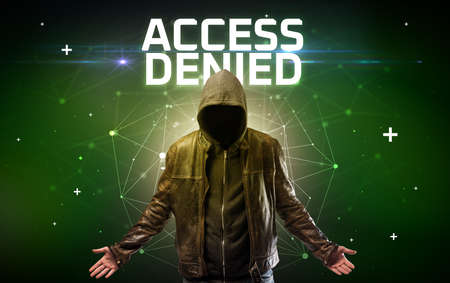 Mysterious hacker with ACCESS DENIED inscription, online attack concept inscription, online security concept