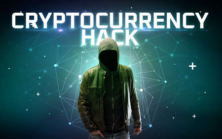 Mysterious hacker with CRYPTOCURRENCY HACK inscription, online attack concept inscription, online security concept Reklamní fotografie