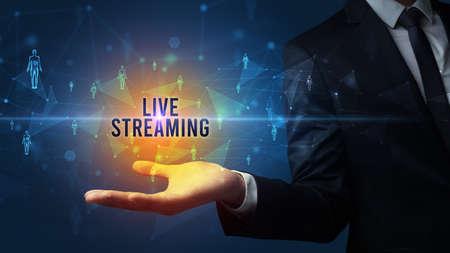 Elegant hand holding LIVE STREAMING inscription, social networking concept