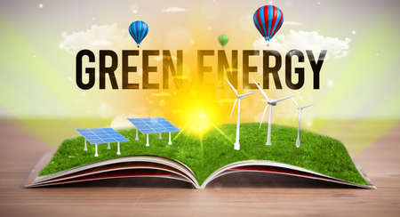 Open book with GREEN ENERGY inscription, renewable energy concept