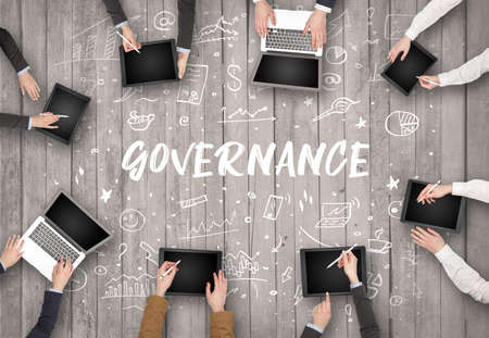 Group of business people working in office with GOVERNANCE inscription, coworking concept Stock Photo