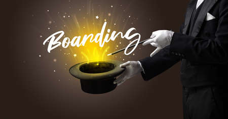 Magician is showing magic trick with Boarding inscription, traveling concept