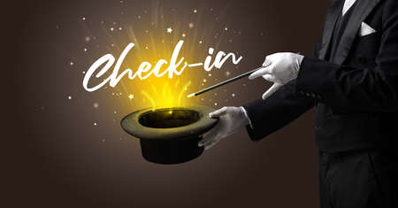 Magician is showing magic trick with Check-in inscription, traveling concept