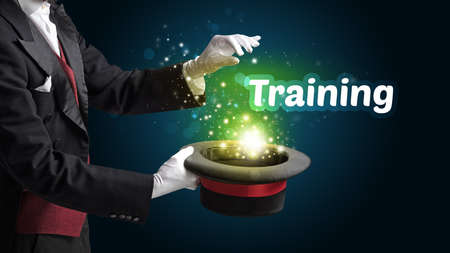 Magician is showing magic trick with Training inscription, educational concept