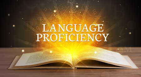 LANGUAGE PROFICIENCY inscription coming out from an open book, educational concept Stockfoto