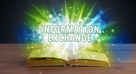 INFORMATION EXCHANGE inscription coming out from an open book, educational concept Stockfoto