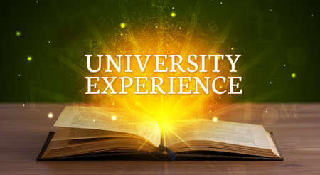 UNIVERSITY EXPERIENCE inscription coming out from an open book, educational concept Stockfoto