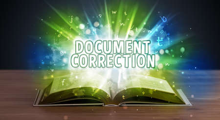 DOCUMENT CORRECTION inscription coming out from an open book, educational concept Stockfoto