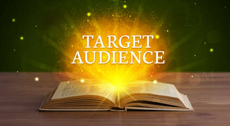 TARGET AUDIENCE inscription coming out from an open book, educational concept Stockfoto