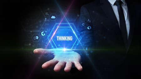 Man hand holding THINKING inscription, social media concept