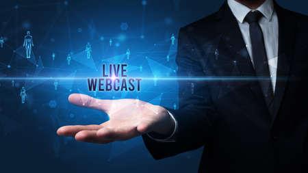 Elegant hand holding LIVE WEBCAST inscription, social networking concept Foto de archivo