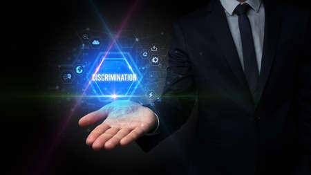 Man hand holding DISCRIMINATION inscription, social media concept