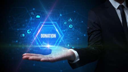 Man hand holding DONATION inscription, social media concept