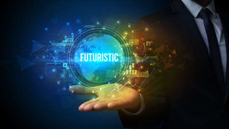 Elegant hand holding FUTURISTIC inscription, digital technology concept Foto de archivo