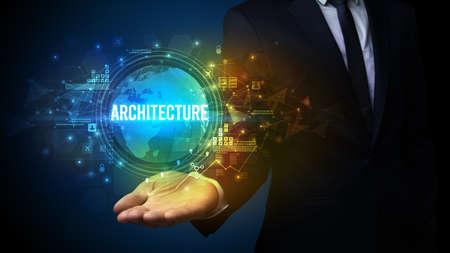Elegant hand holding ARCHITECTURE inscription, digital technology concept Foto de archivo