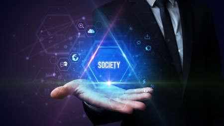 Man hand holding SOCIETY inscription, social media concept