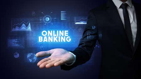 Hand of Businessman holding ONLINE BANKING inscription, business success concept