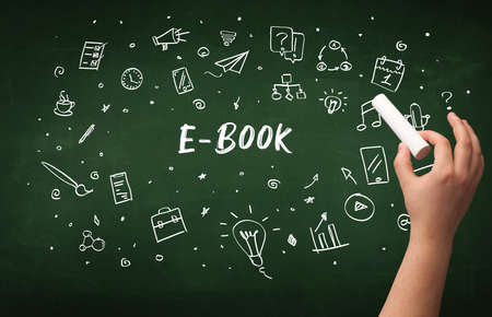 Hand drawing E-BOOK inscription with white chalk on blackboard, education concept Stock Photo