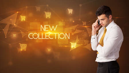 Businessman with shopping cart icons and NEW COLLECTION inscription, online shopping concept 写真素材