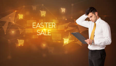 Businessman with shopping cart icons and EASTER SALE inscription, online shopping concept