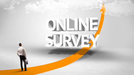 Rear view of a businessman standing in front of ONLINE SURVEY inscription, successful business concept
