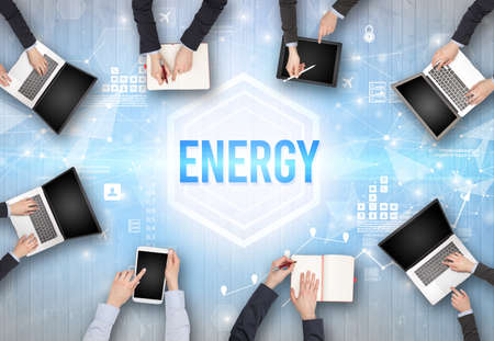 Group of Busy People Working in an Office with ENERGY inscription, modern technology concept