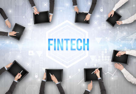 Group of Busy People Working in an Office with FINTECH inscription, modern technology concept