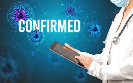 doctor prescribes a prescription with CONFIRMED  inscription, pandemic concept