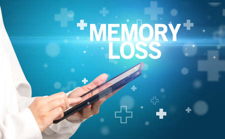 doctor writes notes on the clipboard with MEMORY LOSS inscription, first aid concept